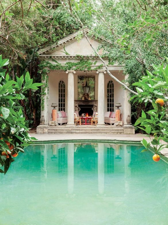 The pool house amid the rampant growth of ivy, citrus trees and ficus by Richard Shapiro design