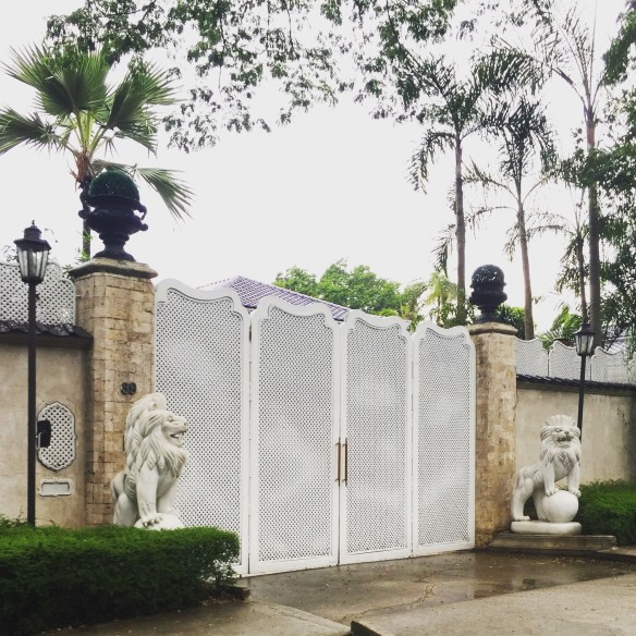 Gated enterance in Manila via The Potted Boxwood