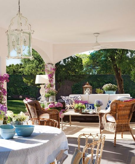 bougainvillea columns on this patio via Mix and Chic