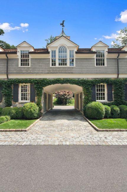 fantastic arched driveway via Homebunch