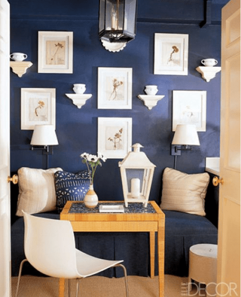 Navy gallery wall via Elle Decor