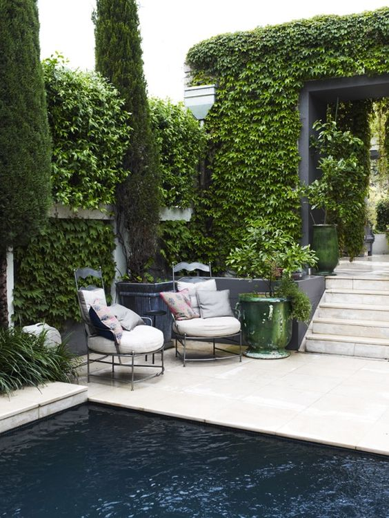Gorgeous Ivy covered pool area via prepaganda