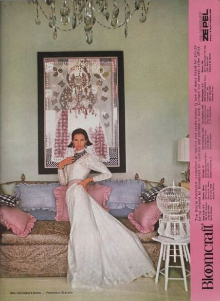 Gloria Vanderbilt posing in her NY apartment for Bloomcraft. AD May/June 1974