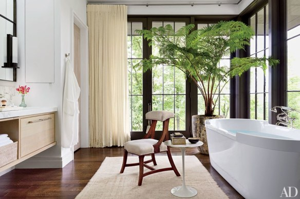 Plant in the bathroom of Ray Booth and John Sheas Nashville Home via AD