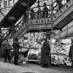 """This New York newsstand features a January 1903 number of """"The Argosy"""" hanging from its lower right side."""