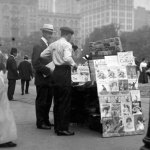 """In this June 1913 photo, there's a """"Popular Magazine"""" in the side display of this newsstand, and """"Adventure"""" (just the nameplate visible) on the bottom row of the top display."""