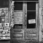"""A number of fiction magazines, but not a whole lot of pulps, surround the doors of this Washington, D.C., drugstore. There are a couple of copies of the March 6, 1920, number of """"All-Story Weekly"""" visible."""