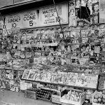 This newsstand at East 32nd Street and Third Avenue, New York City, teams with pulps from October and November 1935.