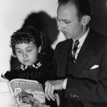 """John Qualen and Jane Withers, who play father and daughter in the movie """"Angel's Holiday,"""" look over the May 16, 1936, number of """"Detective Fiction Weekly"""" in this publicity photo."""