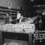 """This photo may be familiar to any of you who attended Pulpcon or PulpFest in Dayton, Ohio. It hangs on the wall of Bonnett's Books on 5th Street, and shows the interior of that very location in 1941. At the time, Bonnett's specialized in used magazines. And as you can see in this photo, there are stacks and stacks and stacks of pulp magazines, including """"Spicy Adventures,"""" """"Spicy Mystery"""" and """"Spicy Detective"""" in the foreground. (Photo courtesy of Bonnett's Books)"""