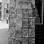 Also from July 1942, this rack in Yreka, Calif., displays the headline of the day above a selection of pulp magazines.