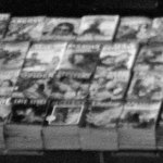 """In this fuzzy detail of the previous Union Station photo, you can make out stacks of """"Argosy"""" (February 1943), """"Adventure"""" (February 1943), """"Black Mask"""" (March 1943), """"The Spider"""" (February 1943), """"Love Stories"""" and several detective pulps."""