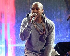 NEW YORK, NY - DECEMBER 01:  Kanye West performs at the surprise World AIDS Day (RED) Concert in Times Square on December 1, 2014 in New York City.  (Photo by Taylor Hill/FilmMagic)