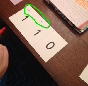 Trying to show 110 with place value cards_zoomed