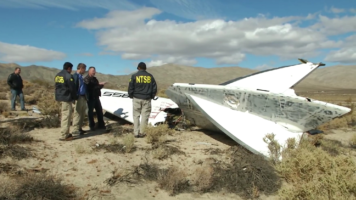 NTSB_Go-Team_inspects_a_tail_section_of_VSS_Enterprise