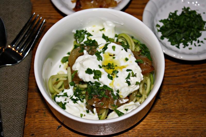 large angle close zucchini noodles w onions and yogurt