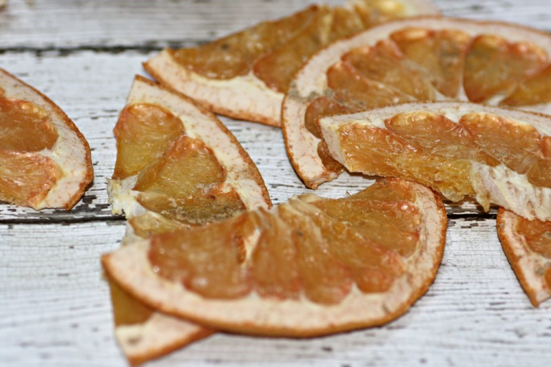 dehydrated grapefruit slices on wood planks