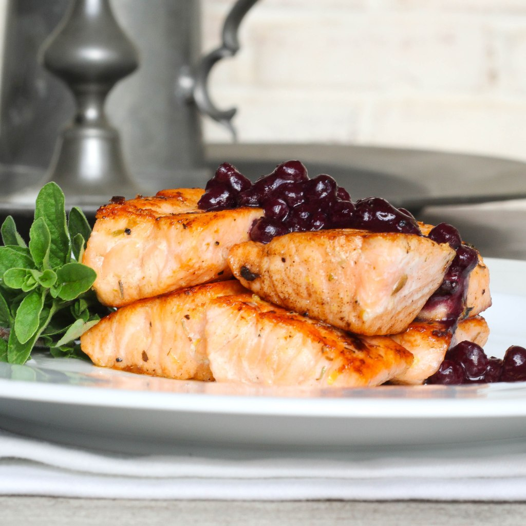 butter rubbed salmon with blueberry sauce