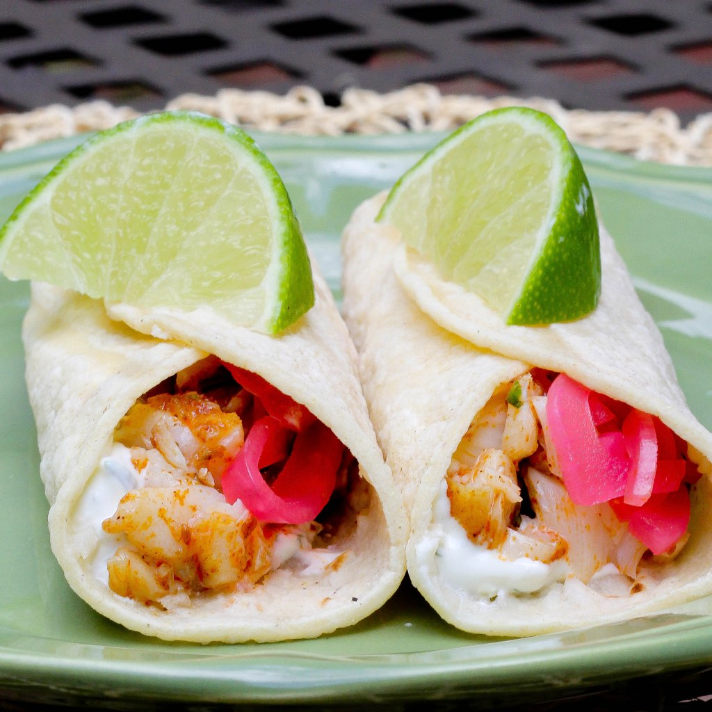 Flaky Fish Tacos with Marinated Red Onions and Cilantro Cream