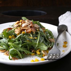 Spicy Greens with Roasted Corn and Creamy Manchego Dressing