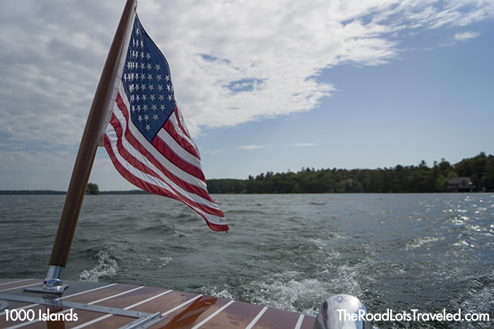 American flag at the back of wooden boat Gadfly during a boat ride, 1000 Islands