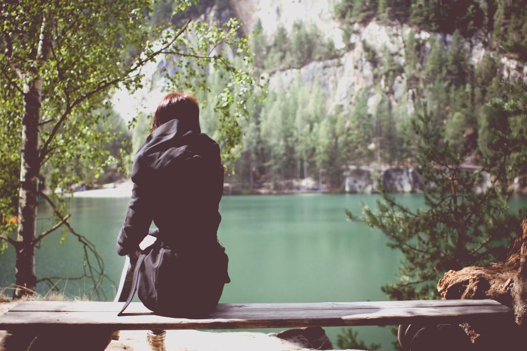 Girl Sitting By Lake 2