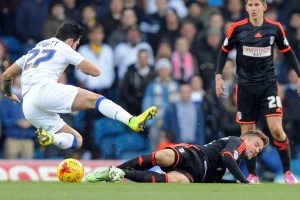 Lasse Vigen Christensen of Fulham tackles Alex Mowatt of Leeds United