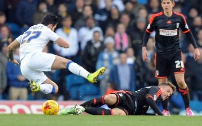 Lasse Vigen Christensen of Fulham tackles Alex Mowatt of Leeds United