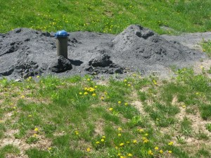 What comes out of the ground with new well