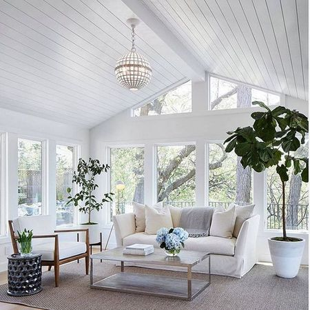 16 Sunroom Decor Ideas white sunroom with a couch