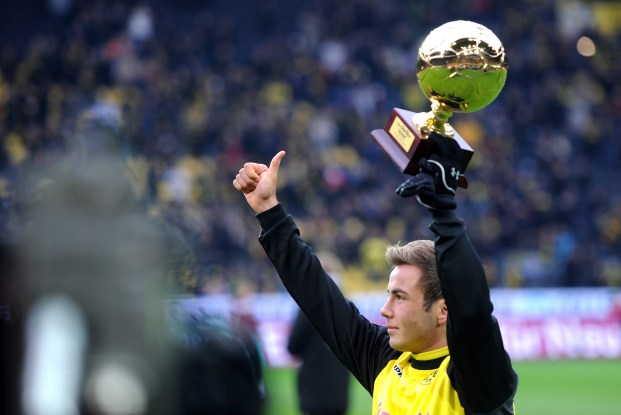 Dortmund's midfielder Mario Goetze holds his Golden Boy 2011 trophy after being awarded the best European under-21 player of the year prior to the German first division Bundesliga football match Borussia Dortmund vs 1.FC Kaiserslautern in the German city of Dortmund on December 11, 2011. AFP PHOTO / PATRIK STOLLARZ RESTRICTIONS / EMBARGO - DFL LIMITS THE USE OF IMAGES ON THE INTERNET TO 15 PICTURES (NO VIDEO-LIKE SEQUENCES) DURING THE MATCH AND PROHIBITS MOBILE (MMS) USE DURING AND FOR FURTHER TWO HOURS AFTER THE MATCH. FOR MORE INFORMATION CONTACT DFL. (Photo credit should read PATRIK STOLLARZ/AFP/Getty Images)