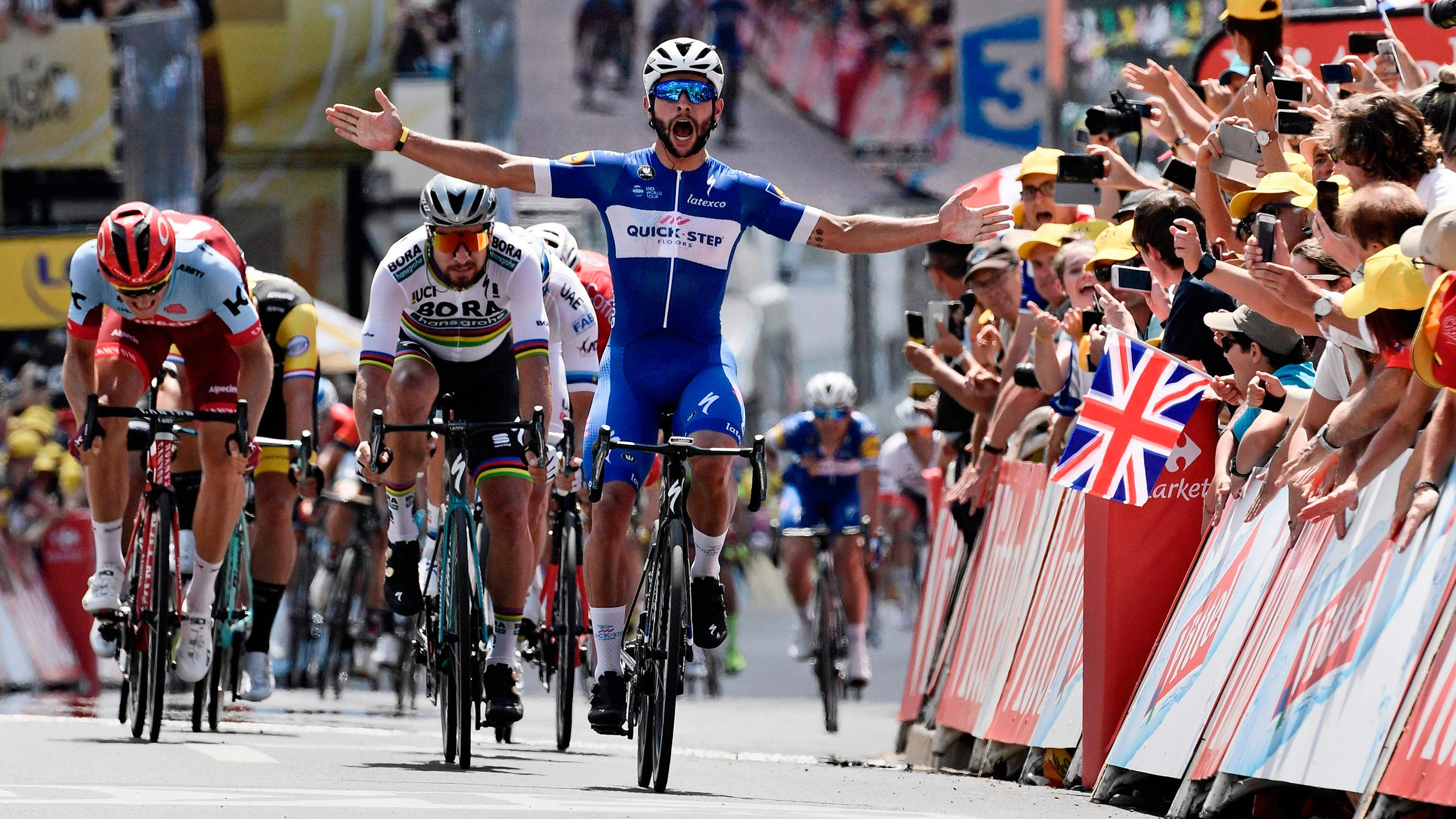 Tour de France 2018  Chris Froome crashes in chaotic finish   Sport     Victory roar  Colombia s Fernando Gaviria celebrates crossing the line to  win the first stage of