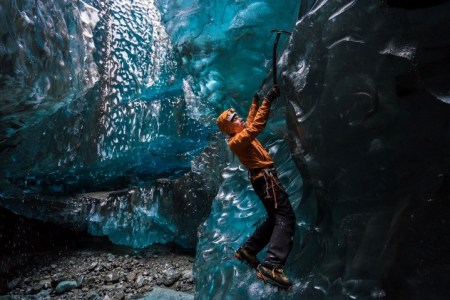 Wednesday 25th November 2015, Vatnajökull national park, Iceland: Photographer Mikael Buck with assistance from renowned local Icelandic guide Einar Runar Sigurdsson, explored the frozen world of Vatnajökull glacier in Iceland using Sony's world first back-illuminated full-frame sensor – which features in the ?7R II camera. His images were taken without use of a tripod or any image stitching techniques in photoshop. This was made possible through Sony's new sensor technology, allowing incredibly detailed low-light hand held photography. Previously images this detailed would have required carrying bulky equipment to the caves, some of which can require hiking and climbing over a glacier for up to two hours to to access. This picture: Guide Einar Runar Sigurdsson is seen ice climbing inside the 'Waterfall Cave' PR Handout - editorial usage only. Photographer's details not to be removed from metadata or byline. For further information please contact Rochelle Collison at Hope & Glory PR on 020 7014 5306 or rochelle.collison@hopeandglorypr.com Copyright: © Mikael Buck / Sony 07828 201 042 / mikaelbuck@gmail.com