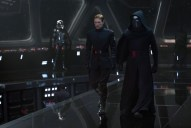 Star Wars: The Force Awakens L to R: General Hux (Domnall Gleeson) and Kylo Ren (Adam Driver), in b/g Captain Phasma (Gwendoline Christie) Ph: David James © 2015 Lucasfilm Ltd. & TM. All Right Reserved.