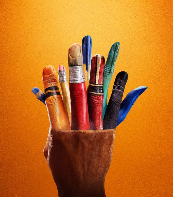 Pencil pot: In another of Massey's photographs, a model's hands and fingers are painted to look like a pot of brightly coloured pens and pencils.