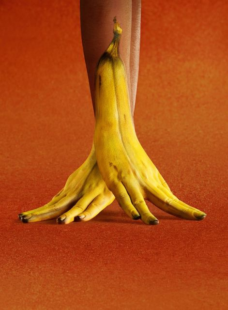 Banana split: London based advertising photographer Ray Massey joined forces with talented body painting experts Annie Miller and Annie Ralli to create this banana split with a difference. A model's hands have been painted yellow and her finger nails brown to create the tip.