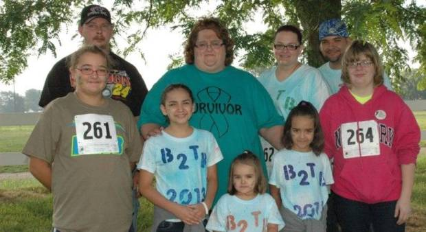 "FAMILY SUPPORT ... (Front) Chelsea Funk, Serenity Bustamante, Nevaeh Bustamante, Jandance Bustamante, Shaunna Hemenway, (Back) Jason Payne, Devin Payne, Racheal Bustamante, and Andrew Bustamante all came out to offer their support by walking the 3 mile route in honor of Devin's battle with cervical cancer and to thank Cancer Assistance of Williams County for their support by ""paying it forward""."