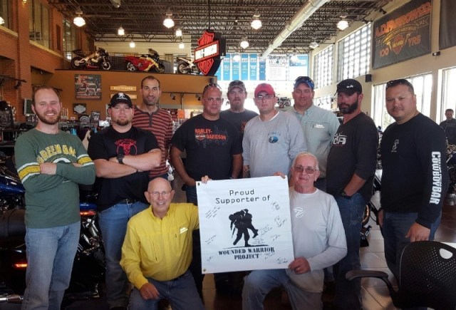 Wounded veterans pose with the Harley-Dealership team after a successful ride in Ohio. (PRNewsFoto/Wounded Warrior Project)