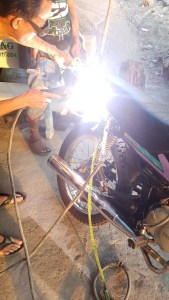 Welding poor Winnie back together during my first motorbike trip