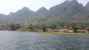 Church steeples and huts all along this river channel to the Phong Nha Cave. Shows how natural this region still is!