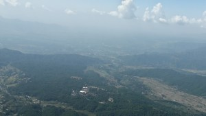 View of Dharamsala from the air while paragliding in Bir