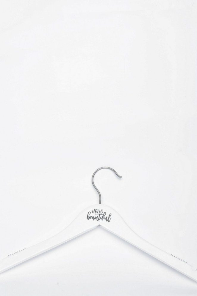WHITE WOODEN HANGER $11