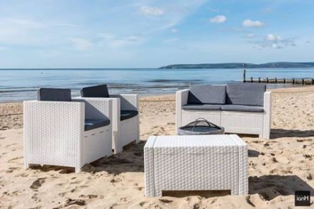 Our white rattan outdoor furniture set on hire at Beach Weddings Bournemouth