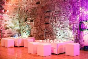 Our white leather chesterfield coffee table with matching leather cubes on hire at Lulworth Castle