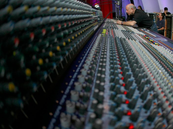 The Who's onstage sound engineer Bob Pridden works his magic at the mixing board during a sound check at the Hollywood Bowl on November 5, 2006.