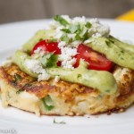 mexican potato cakes with avocado sauce and cotija cheese