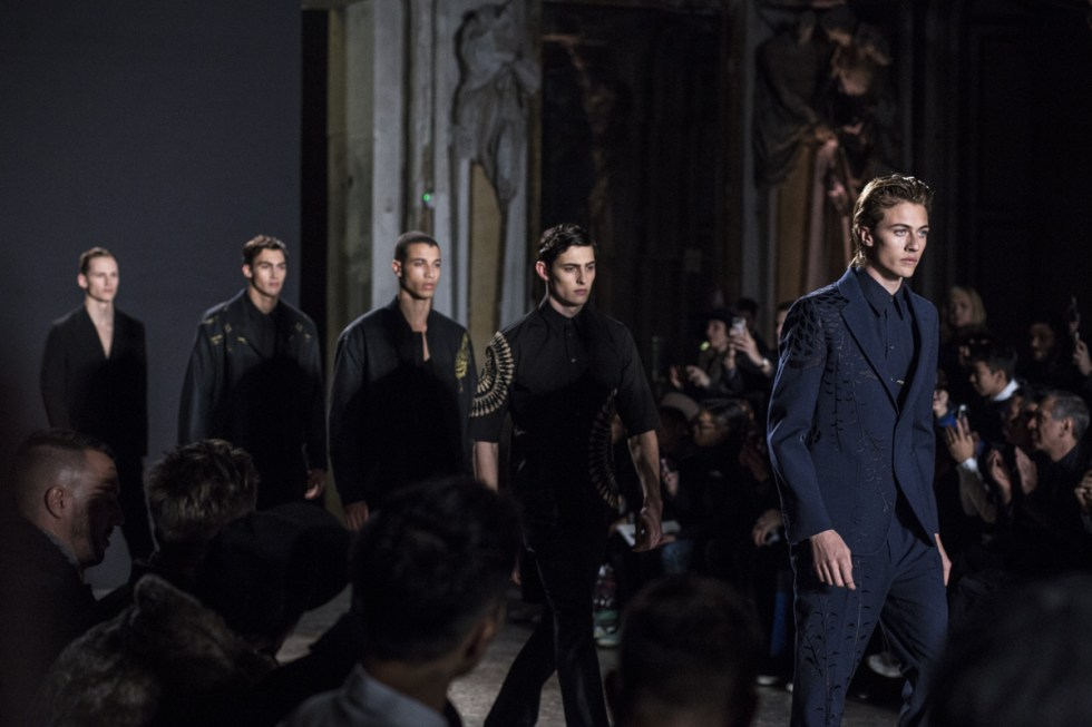instagram famous model Lucky Blue Smith leading the finale for Ports 1961 FW16 menswear show in Milan during MFW day 1, wearing a navy suit with bamboo details