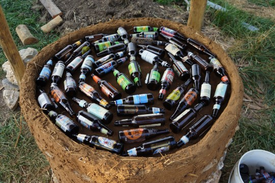 Outdoor Cob Oven: Beer Bottle Insulation