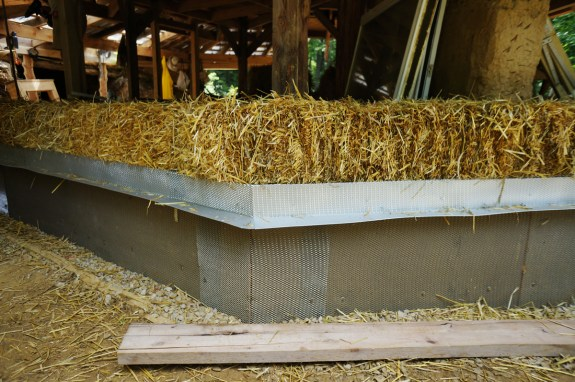 Metal Plaster Stop at Bottom of Straw Bale Wall