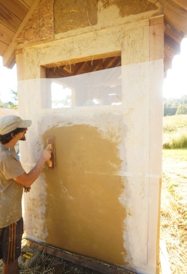 Floating fiberglass mesh in clay plaster